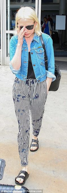 Jetset life: Earlier in the day the mum of one was spotted jetting into Los Angeles in tim...