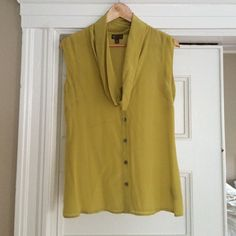 Yellow Silk Cowl Neck Top Gorgeous silk cowl neck top with silver buttons by Fei from Anthropologie. Color is a soft yellow/chartreuse. Great with jeans or a pencil skirt for work. Anthropologie Tops Blouses