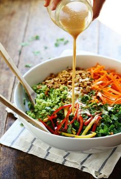 Chopped Thai Salad with Sesame Garlic Dressing - a rainbow of power veggies tossed with a simple made-from-scratch Thai dressing. Sub honey with a #vegan sweetener.