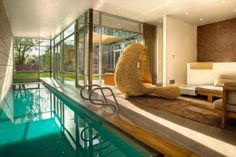 When most people think of swimming pool designs, particularly at someone's home, indoor pools probably aren't the first thing that pop into their heads. Indoor Pools, Small Indoor Pool, Cool Swimming Pools, Swimming Pool Designs, Piscina Interior, Luxury House Plans, Minimalist Home, Luxury Homes, House Design