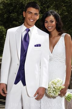 Stephen Geoffrey Troy White Tuxedo with purple accessories. And, don't forget the purple pocket square!