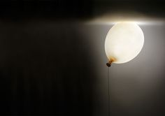 A Whimsical Lamp That Looks Like a Gravity-Defying Helium Balloon