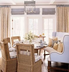 beach house dining room - Promote comfort and coziness around your dining table. Here, an oval table hosts a curved leather banquette and four wicker chairs.I want the curved sofa for the dining room! Decor, Dining Room Chairs, Interior Design, Dining Room Design, Room, Interior, Beach Dining Room, Beach House Dining Room, Home Decor