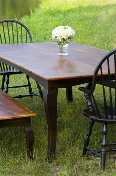 Farm table made of reclaimed pine barn wood with cabriole legs and new England Windsor chairs