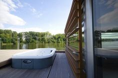 Milan Řídký designed this minimalist floating home in the Czech Republic. It has a small loft-like space and is clad in sustainable beech wood Buy A Boat, Wooden Screen, Water House, Small Loft, Floating House, Green Building, Wood Paneling, Diy Design, Minimalist