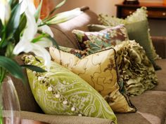 Natural Palette - 12 Ways to Bring Color to a Room With Pillows on HGTV Green, yellow and brown decorative pillows brighten up a solid tan couch with a natural — but lively — color palette. Colorful Throw Pillows, Decorative Throw Pillows, Green Pillows, Decorative Accents, White Pillows, Accent Pillows, Living Room Colors, Living Room Designs, Living Rooms