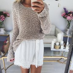 We love the texture of this open knit sweater paired with a white embroidered shorts