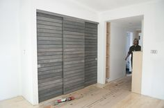 This is the master bedroom closet with three sliding doors. The ensuite is also a barn door, but it is sliding on the Heavy Metal barn door hardware.