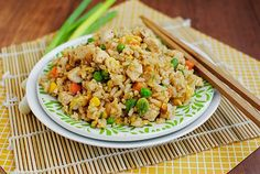 Homemade Chicken Fried Rice  2c prepared rice  1 chicken breast, cut into bite-sized pieces and seasoned with salt & pepper (or leftover cooked chicken)  1/2 c frozen mixed vegetables  2 green onions, chopped  1 clove garlic, minced  1 egg  3 tsp sesame or wok oil, divided  2 Tbsp soy sauce