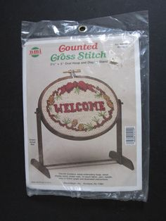Welcome Counted Cross Stitch Kit with Oval Hoop and Display Stand NMI New Sealed Wood Display Stand, Embroidery Fabric, Counted Cross Stitch Kits, Hoop, Frame, Hula Hooping