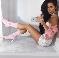 Amber Scholl. Pink sock boots. Long brunette hair. White mini dress.