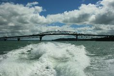Auckland Harbour Bridge and no, it does not connect with the Sydney Harbour Bridge. They are on two different countries separated by the Tasman Sea