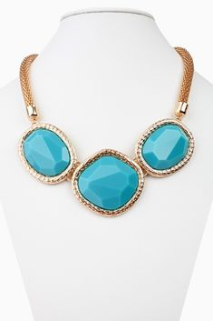 Make a statement with this season's knockout bib necklace and earring set. Aqua-Gold-Jeweled-Stone-Bib-Necklace/Earring-Set