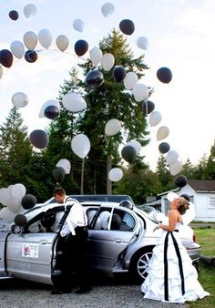 Fill getaway car with balloons. As you make your escape, the balloons will fly out in celebration- I want something like this for my wedding!