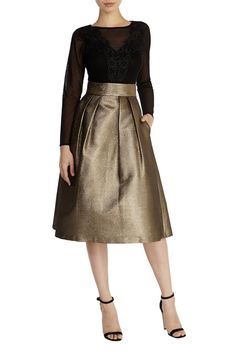With its A-line silhouette and luxe texture, the Melanie Gold Metallic Skirt is a stunning piece which will see you through the seasons in style. Nipping you in at the waist beautifully, the wide waistband makes for an enviable fit whilst structured box pleats exaggerate the fit and flare shape. This skirt measures 73cm from centre back underband to hem