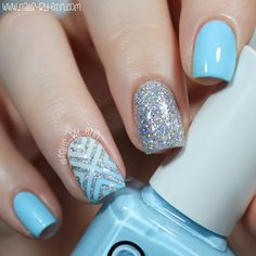 A geometric pattern, silver glitter, and a light blue creme polish make up this easy-on-the-eyes nail art. Watch the video for the instructions and products to recreate this awesome manicure.