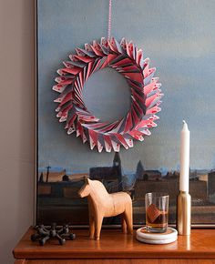 Entertaining: Old-fashioned Parlor Game Party. We crafted a super simple playing card wreath by folding down the corners of red and black playing cards to form triangles and then hot-gluing them into a circle. #party #games #diy