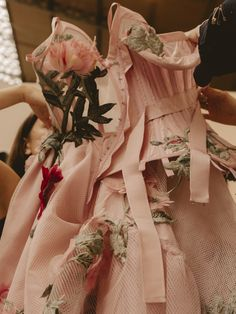 A deconstructed corset dress with trailing garden flower embroideries is created in the atelier in Paris. From the Alexander McQueen Spring/Summer 2018 collection.