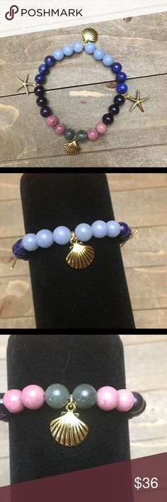 Gemstone Stretch Bracelet (Reserved) I designed this bracelet with natural Amethyst, Lapis Lazuli, Angelite, Rhodonite and African Bloodstone. Features gold sea shell and starfish charms. Handmade Jewelry Bracelets