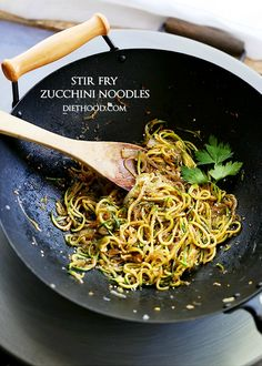 Delicious, low-carb, healthy Stir Fry made with spiralized zucchini and onions tossed with teriyaki sauce and toasted sesame seeds!