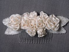 Couture hair piece - beautiful one-of-a kind.  Hand made silk rosettes & beaded lives.  Only one made and available at: www.alterationsavenue.com