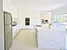 The all-white kitchen: Polyurethane doors, 40mm 'Calacatta Nuvo' Caesarstone bench tops and glass splash.