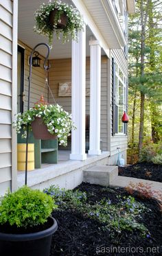 Get ready for SPRING! A small & simple, yet pretty porch with pops of color for the Spring.