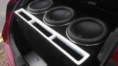 Custom-made box for 3 jl audio 12w7 subs in a Honda Civic