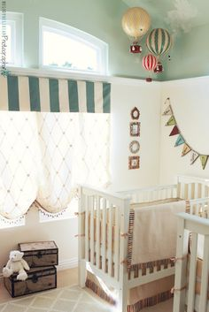 Don't want children, but love this room. I love the wall color, the hot air balloons, and the window treatment. What a cool nursery!