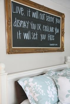 """Love, it will not betray you..."" Mumford & Sons quote on chalkboard over bed"