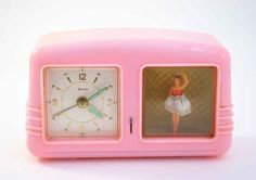 I had a clock exactly like this. Loved it. It played a music box melody as an alarm and the ballerina spun around.