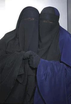 two ladies in niqab with eyes cover