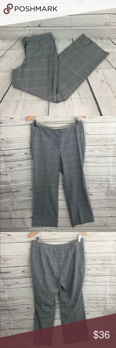 "Michael Kors Plaid Pants Navy Michael Kors Plaid Pants. Size 10. Two front pockets. Material is 65% polyester 34% rayon and 1% spandex. When laid flat waist measures 17"" across and the inseam is 30.5"". Great condition only flaw is tiny, hardly noticeable dot on right thigh as seen in last photo. Michael Kors Pants"