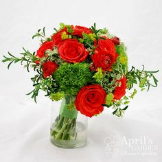 Perfect for a march wedding this #orange and #green Bouquet is stunning! Flowers by April's Garden #wedding