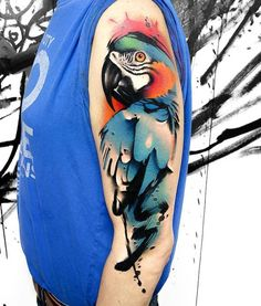 Among the many of bird tattoos, parrot tattoo is especially eye-catching and attractive. It appears on the limbs and bodies of both man and woman. Thigh Tattoo Designs, Feather Tattoo Design, Owl Tattoo Design, Feather Tattoos, Nature Tattoos, Flower Tattoo Designs, Leg Tattoos, Sleeve Tattoos, Bird Tattoos