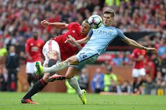 Zlatan Ibrahimovic of Manchester United competes with John Stones of Manchester City. Manchester Derby, Manchester City, Manchester United, John Stones, Premier League, Soccer, The Unit, Pictures, Sports