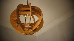 Handmade pendant light from thick cardboard.