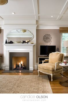 Family Room with Classic White Fireplace • Reading Nook • Mirror Over Fireplace • Ceiling Detail Ideas • #candiceolson #candiceolsondesign Classic Fireplace, White Fireplace, Fireplace Design, Mirror Over Fireplace, Candice Olson, Ceiling Detail, New Home Designs, Reading Nook, Classic White