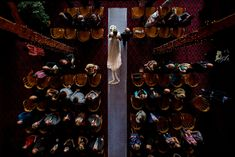 Bird's eye view of father walking his daughter down the aisle at wedding ceremony