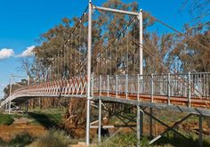 Suspension Footbridge Across An Australian Outback River Print By Paul Donohoe