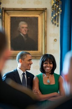 President Barack Obama and First Lady Michelle Obama stand together in the Blue Room of the White House, before a brunch celebrating the Inauguration, Jan. 18, 2013. (Official White House Photo by Pete Souza)