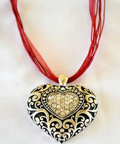 Oversized Heart pendant on 7 strand lace and cord necklace.