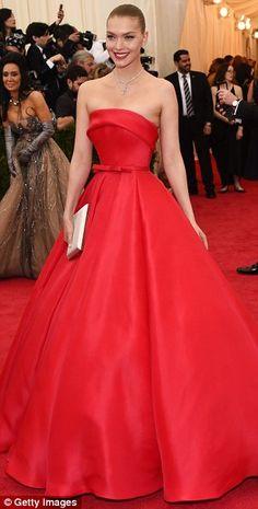 Red alert: Also sporting shades of crimson were (L-R) Monica Bellucci, Elettra Wiedemann a...