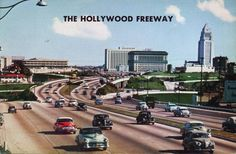 This postcard of the Hollywood Freeway looking toward downtown Los Angeles (that tall building is City Hall ala Dragnet — dumm da dum dummm) is circa 1950, a time when cars were large and smoky and the freeways flowed even in the middle of the day. This view is dwarfed today by the large buildings that create a corridor at this location and, of course, traffic moves along bumper-to-bumper.
