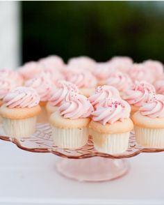 For a pink bridal shower with vintage touches, arrange miniature pink-frosted cupcakes on a pink Depression-glass pedestal.