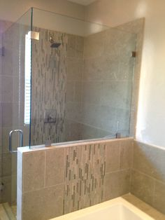 Finished master bath renovation/remodel. Limestone with glass tiles vertical