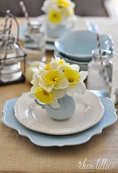 A Simple and Inexpensive Easter Tablesetting Using Blue Dishes from @HomeGoods and free daffodils picked fresh from the yard. Using a little creamer as a vase at each place setting is a fresh and fun little touch. (sponsored pin)