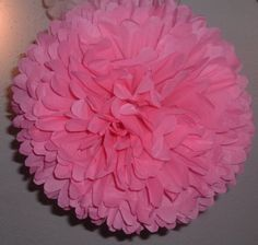 Pretty in pink. 12  large paper pom poms / wedding decorations / bridal shower flowers / birthday decor.