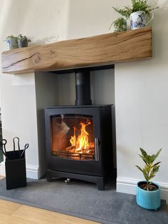 We proudly supply & install some of the greenest woodburning stoves in the world. We install throughout the York, Harrogate and Leeds areas. Wood Burner Fireplace, Home Fireplace, Living Room With Fireplace, Fireplace Design, Fireplaces, Cottage Living Rooms, New Living Room, Living Room Decor, Log Burner Living Room