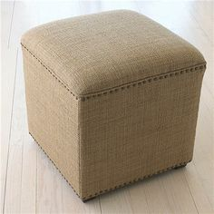 Nailhead Accent Ottoman Stool A nubby rough'n'tough upholstery fabric is perfect for this versatile ottoman that can be both footstool or extra seating. Finished with a nailhead trim for a sophisticated look. Coastal, Beach, Nautical, Nantucket